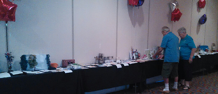 Tom Gruntler and Marlus Johns set up for silent auction